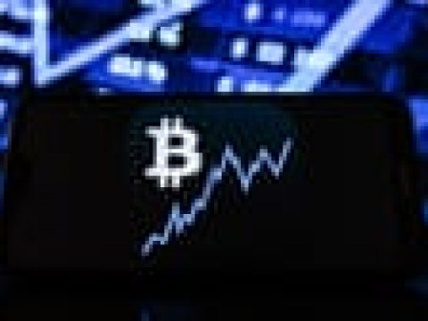 Bitcoin pushes past $47,000 to new record highs – business live